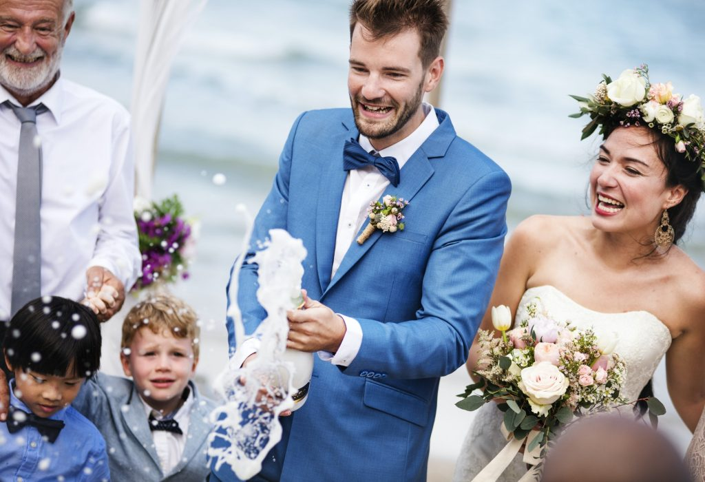 young-couple-in-a-wedding-ceremony-at-the-beach.jpg